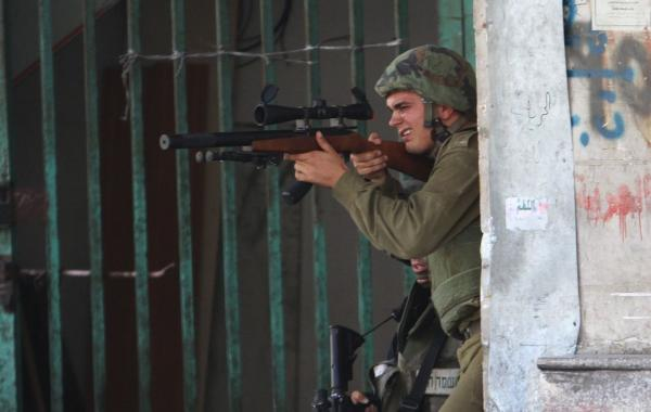 ap-photo-2014-israeli-idf-in-gaza-with-ruger-10-22-1022-10-22-suppressed-with-bx25-mag-516.jpg