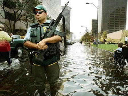 new-orleans-katrina-cop-in-flooded-street-by-afp-152.jpg